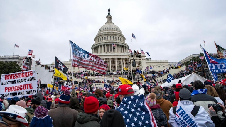 Trump supporters invade US Capitol, 4 die in clash, Congress goes on to certify 306 votes for Biden